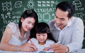 mom, dad, and daughter sitting at a table working on homework