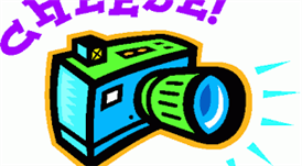 A camera with the word CHEESE above it for Picture Day.