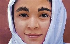 ERHS student artist drawn portrait of a young girl from Afhanistan.
